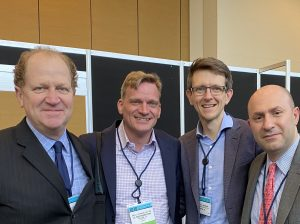Bryan Lewis, President of KidneyCAN, with Dr. Hans Hammers, Dr. Bradley McGregor, and Dr. Toni Choueiri at at the 2020 Genitourinary Cancers Symposium